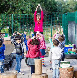 Pictured: Rena Swinton led the pupils in some warming up exercises<br /> <br /> Education Secretary John Swinney MSP met staff and children at Davidson's Mains Primary School nursery today as he reaffirmed his commitment to the transformation of early learning and childcare. <br /> <br /> Ger Harley: 6 September 2018