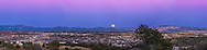 The Full &ldquo;Snow&rdquo; Moon of February 3, 2015 rising over Silver City, New Mexico in the darkening twilight. Jupiter, near opposition, is visible to the left of the Moon. The sky above is pink from the Belt of Venus. I shot this from the Boston Hill trailhead at Market Street and Highway 180 west of the city. The coppery Moon rises to the left of the Santa Rita Copper Mine, at the right of the image.<br /> <br /> This is a 5-panel panorama shot with the Canon 6D and 135mm Canon lens to cover the sweep of the horizon.