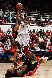 February 24, 2011; Stanford, CA, USA;  Stanford Cardinal forward Chiney Ogwumike (13) shoots over Oregon St. Beavers forward El Sara Greer (34) after being called for an intentional foul during the first half at Maples Pavilion.