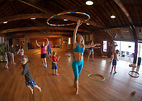 Erin Lovett Sherman demonstrates a hoop class during her artist in residence with Sandy Island Family Camp on Lake Winnipesaukee Friday morning.  (Karen Bobotas/for the Laconia Daily Sun)
