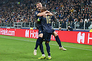 Manchester United Defender Luke Shaw celebrates with Manchester United Midfielder Ashley Young the own goal by Juventus Defender Alex Sandro (not in picture) 1-2 during the Champions League Group H match between Juventus FC and Manchester United at the Allianz Stadium, Turin, Italy on 7 November 2018.