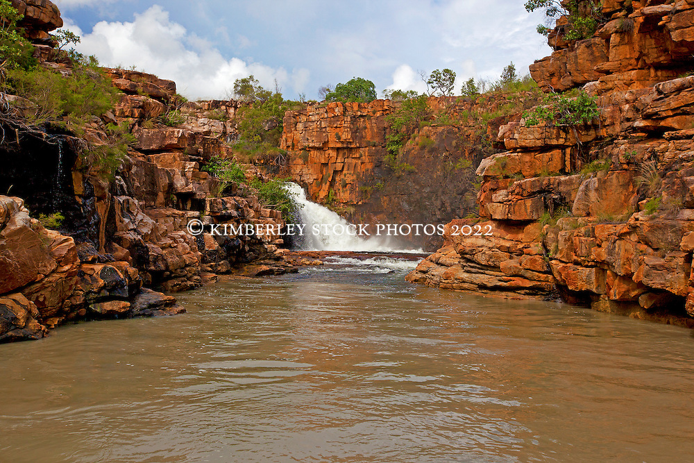 A massive volume of water flowing into Ruby Falls in the 2011 Kimberley wet season, regarded as one of the best on record.  The pool at the bottom of the waterfall is normally a safe swimming hole, but too dangerous to swim in the wet when the waterfalls creates whirlpools.