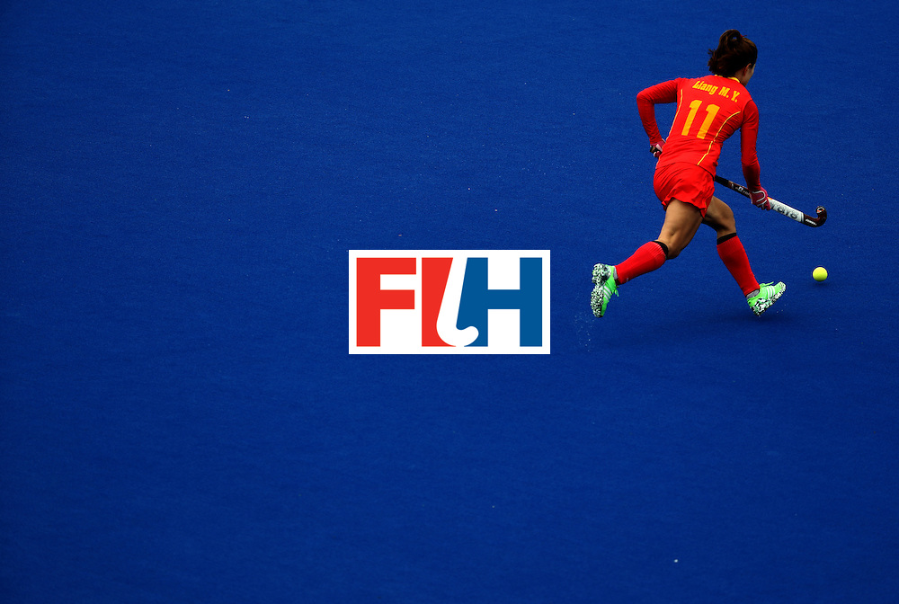 RIO DE JANEIRO, BRAZIL - AUGUST 12:  Meiyu Liang #11 of China runs upfield against Korea during a Women's Preliminary Pool A match on Day 7 of the Rio 2016 Olympic Games at the Olympic Hockey Centre on August 12, 2016 in Rio de Janeiro, Brazil.  (Photo by Sean Haffey/Getty Images)