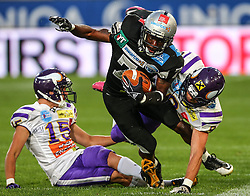 06.07.2013, Tivoli Stadion, Innsbruck, AUT, EFL Finale, Eurobowl XXVII, Swarco Raiders Tirol (AUT) vs Raiffeisen Vikings Vienna (AUT), im Bild  Daniel Auboeck, (Raiffeisen Vikings Vienna, DB, #15), Jaycen Taylor Spears, (SWARCO Raiders Tirol, RB, #7) und  Peter Tutsch , (Raiffeisen Vikings Vienna, DB, #9)  // during the Eurobowl XXVII between Swarco Raiders Tirol (AUT) and Raiffeisen Vikings Vienna (AUT) at the Tivoli Stadion, Innsbruck, Austria on 2013/07/06. EXPA Pictures © 2013, PhotoCredit: EXPA/ Thomas Haumer