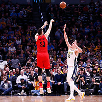 09 April 2018: Portland Trail Blazers center Zach Collins (33) takes a jump shot over Denver Nuggets center Nikola Jokic (15) during the Denver Nuggets 88-82 victory over the Portland Trail Blazers, at the Pepsi Center, Denver, Colorado, USA.