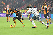 Hull City player Oumar Niasse (24) and Manchester United player Matteo Darmian (36)  during the EFL Cup semi final match 2 between Hull City and Manchester United at the KCOM Stadium, Kingston upon Hull, England on 26 January 2017. Photo by Ian Lyall.