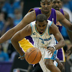 April 28, 2011; New Orleans, LA, USA; New Orleans Hornets point guard Chris Paul (3) is defended by Los Angeles Lakers small forward Ron Artest (15) during the first quarter in game six of the first round of the 2011 NBA playoffs at the New Orleans Arena.    Mandatory Credit: Derick E. Hingle
