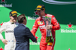 November 12, 2017 - Sao Paulo, Sao Paulo, Brazil - Nov, 2017 - Sao Paulo, Sao Paulo, Brazil - In the photo VETTEL receives the trophy from the hands of the mayor of Sao Paulo JOAO DORIA. German driver SEBASTIAN VETTEL/Scuderia Ferrari won the Brazilian Formula One Grand Prix on Sunday at the Interlagos autodromo in Sao Paulo. VALTTERI BOTTAS/Mercedes AMG was second place, followed by filipinos KIMI RAIKKONEN/Scuderia Ferrari. (Credit Image: © Marcelo Chello via ZUMA Wire)