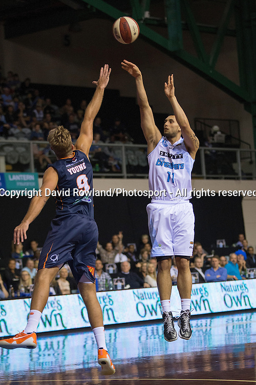 Breakers` Duane Bailey is challenged by Taipans` Mitch Young in the SkyCity Breakers v Cairns Taipans, 2014/15 ANBL Basketball Season, North Shore Events Centre, Auckland, New Zealand, Thursday, October 23, 2014. Photo: David Rowland/Photosport