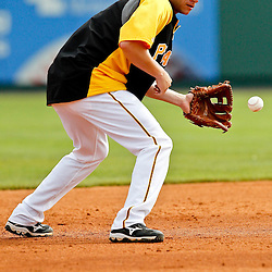March 22, 2012; Bradenton, FL, USA; Pittsburgh Pirates shortstop Clint Barmes (12) works on drills before a spring training game against the Tampa Bay Rays at McKechnie Field. Mandatory Credit: Derick E. Hingle-US PRESSWIRE