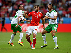 Sam Vokes of Wales battles for the ball with, Corry Evans of Northern Ireland and Gareth McAuley of Northern Ireland  - Mandatory by-line: Joe Meredith/JMP - 25/06/2016 - FOOTBALL - Parc des Princes - Paris, France - Wales v Northern Ireland - UEFA European Championship Round of 16