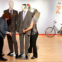 Museum of Art and History Curator Susan Leask and MAH Executive Director Nina Simon get a pair of elegantly dressed mannequins into position in the 'All You Need is Love' show at the museum on April 17.<br />