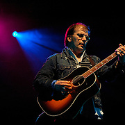 Steve Earle performing at the Wychwood Festival.