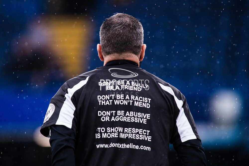 official referee Kevin Friend wearing Don't x the line foundation t-shirt   during the warm up before Premier League match between Chelsea and West Ham United at Stamford Bridge, London, England on 8 April 2018. Picture by Sebastian Frej.