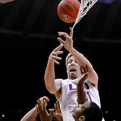 November 23, 2011; Baton Rouge, LA; LSU Tigers center Justin Hamilton (41) catches his finger in the net while jumping for a rebound during the first half of a game against the South Alabama Jaguars at the Pete Maravich Assembly Center.  Mandatory Credit: Derick E. Hingle-US PRESSWIRE