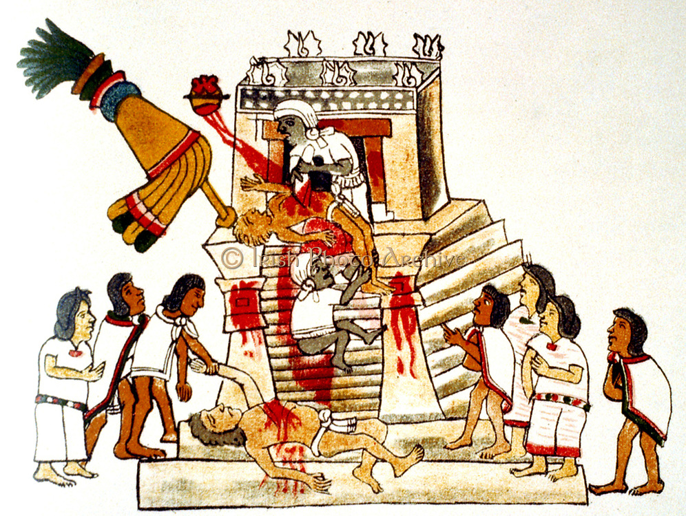 Priest offering the heart taken from a living human victim to the Aztec sun god and god of war, Huitzilopochtli. Print of facsimile from Aztec Codex, published 1904. Human Sacrifice
