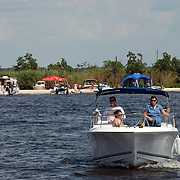 Weekend boating along the shore of Lake Pontchartain at the mouth of the Tchefuncte River near Madisonville, LA. Photo by Lori Waselchuk