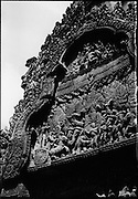 Pediment at Banteay Srey. The temple was constructed under the powerful king Rajendravarman and later under Jayavarman V. The deep and intricate carvings of Banteay Srey are some of the finest examples of classical Khmer art.