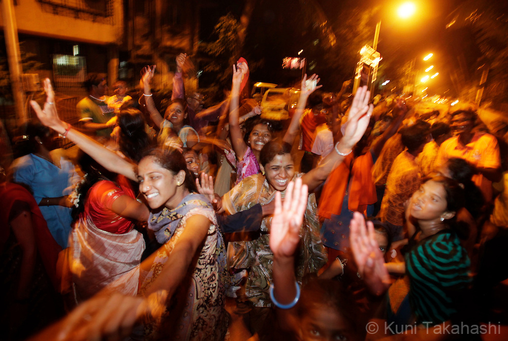 Hindu devotees celebrate on the street in Mumbai, India on Sep 16, 2010 on the 6th day of Ganpati festival. The 10-day hindu festival, celebrating the birthday of Lord Ganesha who is widely worshiped as the god of wisdom, prosperity and good fortune, attracts tens of thousands people.<br /> Photo by Kuni Takahashi