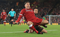 Liverpool's Roberto Firmino (left) is tackled by Swansea City's Martin Olsson during the Premier League match at Anfield, Liverpool.