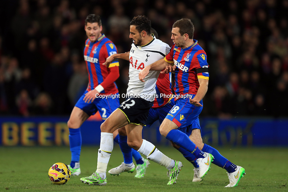 10 January 2015 - Barclays Premier League - Crystal Palace v Tottenham Hotspur - Nacer Chadli of Tottenham Hotspur tangles with James McArthur (R) and Joel Ward of Crystal Palace - Photo: Marc Atkins / Offside.