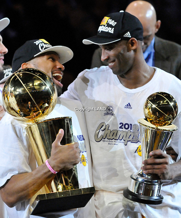Derek Fisher and Kobe Bryant celebrate while holding the championship and MVP throphies. The Lakers defeated the Boston Celtics in game 7 of the NBA Finals  83-79 in Los Angeles, CA 06/16/2010 (John McCoy/Staff Photographer).