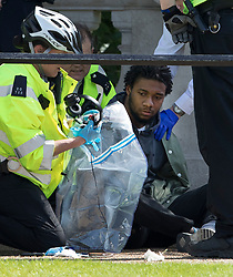 © Licensed to London News Pictures. 24/05/2017. London, UK. Police look through the possessions of a man they detained opposite Buckingham Palace just before the Changing of the Guard ceremony was due to take place. Today's ceremony has been cancelled.  The terrorism threat level has been raised to critical and Operation Temperer has been deployed. 5,000 troops are taking over patrol duties under police command. Photo credit: Peter Macdiarmid/LNP
