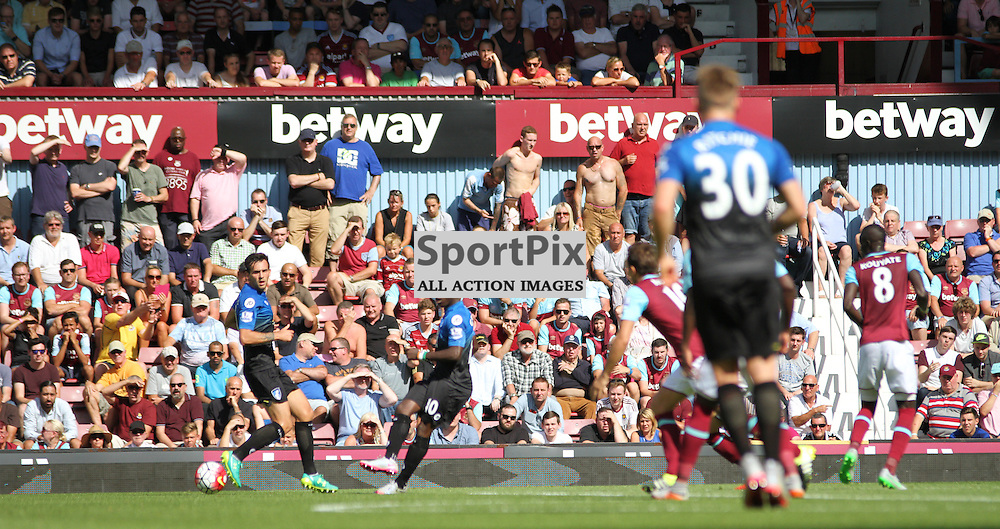 Fans in the sun choose to watch without their shirts on During West Ham United vs Bournemouth FC on Saturday the 22nd August 2015