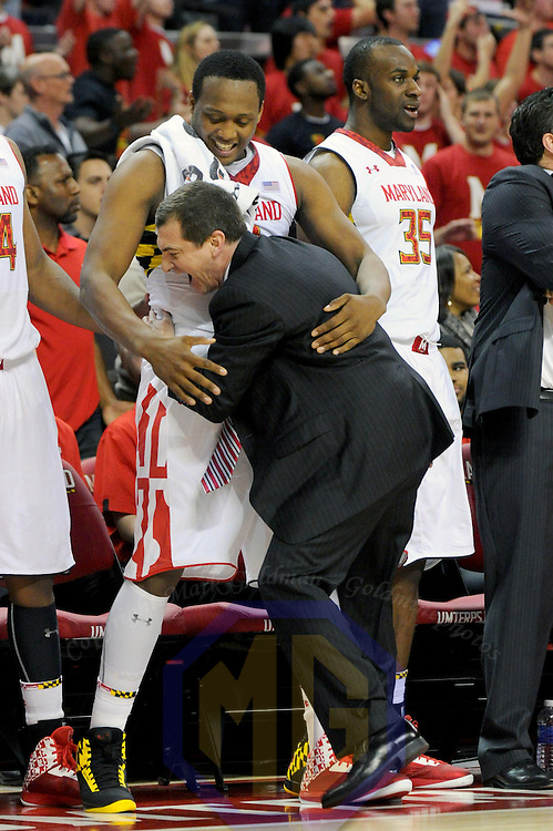 16 February 2013:   Maryland Terrapins head coach Mark Turgeon hugs Maryland Terrapins forward Charles Mitchell (0) in action against the  Duke Blue Devils at the Comcast Center in College Park, MD. where the Maryland Terrapins upset the second ranked Duke Blue Devils, 83-81.