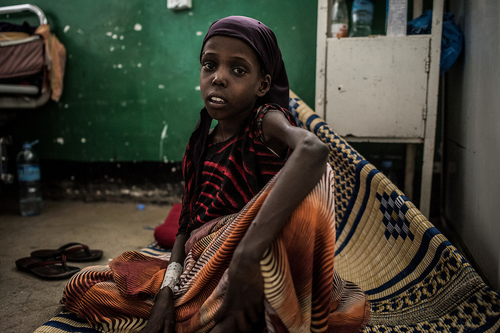 Faysa Hasan, 5, sits on the floor of emergency ward of Borama Regional Hospital in Somalia on March 21, 2017. Faysa was admitted to the hospital weighing only 11 kilograms after traveling from pastoral lands 17 kilometers away. Drought has particularly targeted pastoralists throughout the country, killing camels and livestock, leaving people with no source of income or food.