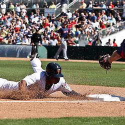 March 11, 2011; Fort Myers, FL, USA; Minnesota Twins second baseman Tsuyoshi Nishioka (1) steals third base past Boston Red Sox third baseman Kevin Youkilis (20) during a spring training exhibition game at Hammond Stadium.   Mandatory Credit: Derick E. Hingle