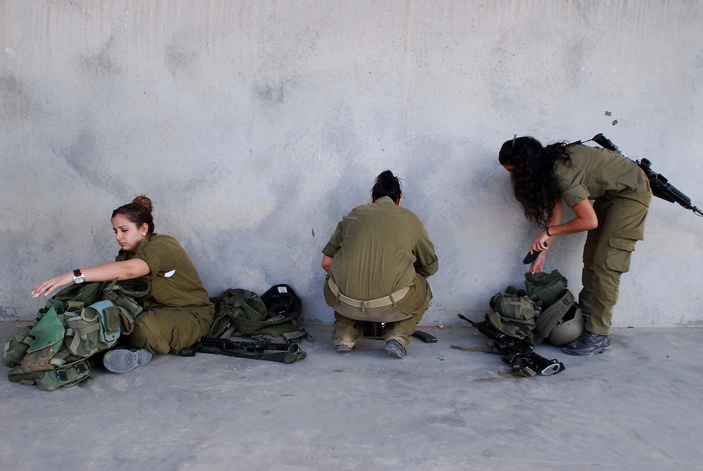 IDF woman reserve soldiers prepare for shooting practice during training in the Negev Desert, South Israel on September 15, 2008. Following their active service, women, like men, are in theory required to serve up to one month annually in reserve duty. However, in practice only some women, mostly in combat roles, get called for active reserve duty, and only for a few years following their active service, with many exit points (e.g., pregnancy).