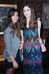 Left to right, sisters AMBER DONOSO and OLIVIA DONOSO at a private view of Sacha Jafri's paintings entitled 'London to India' held in aid of The Elephant Family charity at 23 Macklin Street, Covent Garden, London on 3rd June 2010.