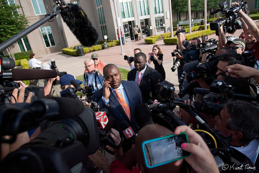 April 20, 2012 - Sanford, Florida, U.S. - Martin family attorney DARYL PARKS talks on his cell phone in front of the press after George Zimmerman's bond was set to $150,000 for the murder of Trayvon Martin at the Sanford Criminal Justice Center in Sanford, Florida.