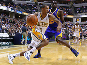 Feb. 28, 2012; Indianapolis, IN, USA; Indiana Pacers shooting guard George Hill (3) dribbles the ball against Golden State Warriors power forward Ekpe Udoh (20) at Bankers Life Fieldhouse. Mandatory credit: Michael Hickey-US PRESSWIRE