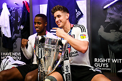 Free to use courtesy of Sky Bet. Tom Cairney and Ryan Sessegnon hold the trophy as Fulham celebrate in the dressing room after winning the game 0-1 to win the Sky Bet Championship Play-Off Final and secure Promotion to the Premier League - Rogan/JMP - 26/05/2018 - FOOTBALL - Wembley Stadium - London, England - Aston Villa v Fulham - Sky Bet Championship Play-Off Final.