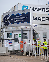 © Licensed to London News Pictures. 20/09/2016. Portsmouth, UK. Workers at entrance to the MMD Shipping Services Ltd yard at Flathouse Quay in Portsmouth Dockyard. The cargo company, owned by Portsmouth City Council, has come under the spotlight of the European Commission's competition unit over whether a bailout from Portsmouth City Council gave the company an unfair advantage over it's competitors. The investigation comes after the UK's vote to leave the European Union. Photo credit: Rob Arnold/LNP