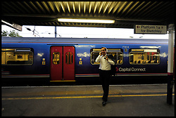 Leader of the Conservative Party David Cameron on the phone at Bedford station after finishing a Cameron Direct in Bedford,Tuesday September 8, 2009 .Photo By Andrew Parsons / i-Images