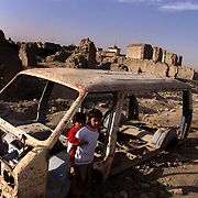 Children in a ravaged Kabul neighborhood in November 2001. Decades of fighting reduced once lively neighborhoods and palaces to rubble.