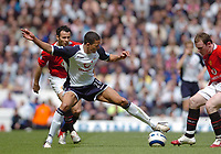 Photo: Leigh Quinnell.<br /> Tottenham Hotspur v Manchester United. The Barclays Premiership. 17/04/2006. Tottenhams Jermaine Jenas stretches to keep the ball from Man Utds'  Wayne Rooney and Ryan Giggs.