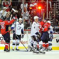 26 December 2007:  Washington Capitals defenseman Shaone Morrisonn (26) raises his arms after the goal light is lit in the first period after Washington Capitals center Dave Steckel scored a goal against the Tampa Bay Lightning on at Verizon Center in Washington. The Capitals defeated the Lightning 3-2.