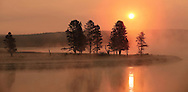 Fog rising from a frigid Alum Creek combines with smoke from nearby wildfires to create this fiery sunrise in Yellowstone National Park.