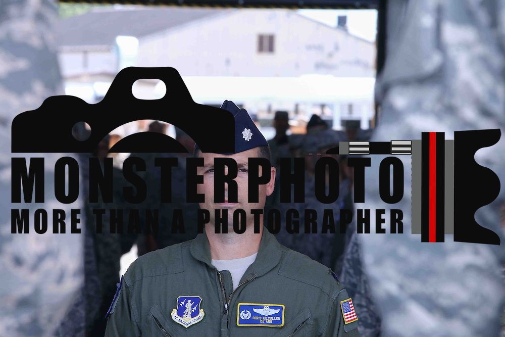 Lt. Col Chris Kilcullen stands at attention during a welcome home and departure ceremony Saturday Aug. 01, 2015 at the Air National Guard Base main hangar in New Castle Delaware.
