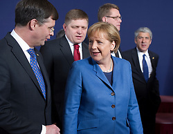 Angela Merkel, Germany's chancellor, center, speaks with Jan Peter Balkenende, the Netherlands's prime minister, left, during the European Summit, in Brussels, on Thursday, March 25, 2010. (Photo © Jock Fistick)