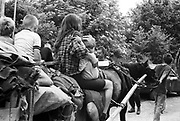 Gipsy travellers riding through a country lane. Glastonbury, Somerset, 1989