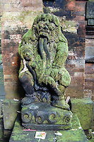 Bali, Gianyar, Ubud. A statue of Rangda, the witch who is feasting on small children, an important mythical figure on Bali. Two of these statues guards the entrance to the inner temple of Pura Prajapati.