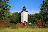 The Presque Isle Lighthouse Tower Rising Above A Sand Dune Covered In Beach Grass On A Warm Summer Afternoon Along Lake Erie At Erie Pennsylvania, USA