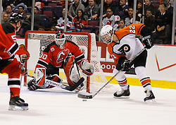 Mar 30, 2007; East Rutherford, NJ, USA; New Jersey Devils goalie Martin Brodeur (30) makes a save on Philadelphia Flyers right wing Mike Knuble (22) during the first period at Continental Airlines Arena in East Rutherford, NJ.
