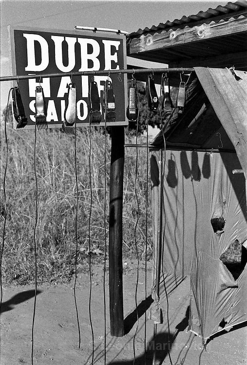 IPLM0017 , South Africa, Venda, June 2001. Roadside hair salon.