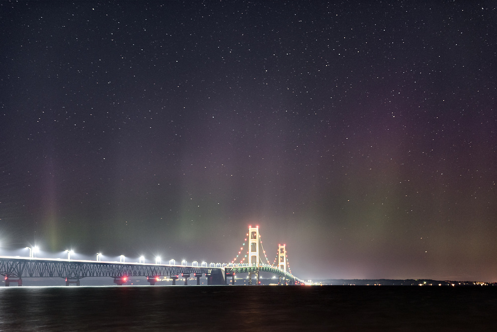 The Aurora Borealis glows over the Mackinac Bridge